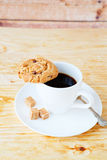 Cup of black coffee and cookies Stock Photography