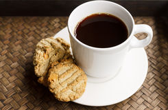 Cup of black coffee with cookies. Coffee with homemade cookies in the morning Royalty Free Stock Photos