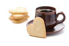 Cup of black coffee and cookies in the shape of heart, isolated Royalty Free Stock Photos