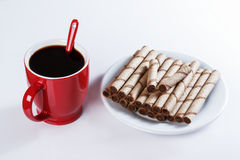 Cup of black coffee, cookies, sweet sticks Royalty Free Stock Photography
