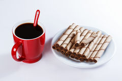 Cup of black coffee, cookies, sweet sticks Royalty Free Stock Photo