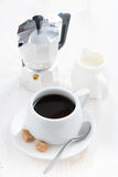 Cup of black coffee, cream and coffeemaker Royalty Free Stock Photos