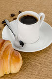 Cup of black coffee and croissant Stock Images