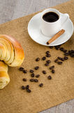 Cup of black coffee and croissant Royalty Free Stock Photos
