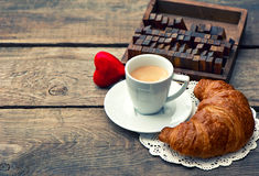 Cup of black coffee with croissant and red heart Stock Photography