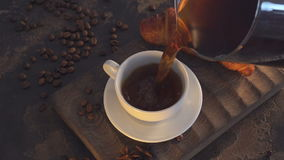 Cup of black coffee and croissant on wooden board stock video