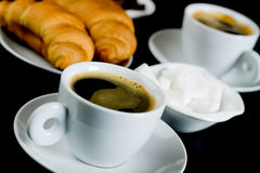 Cup of black coffee with croissants Royalty Free Stock Images