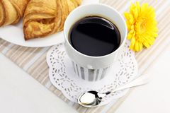 A cup of black coffee and croissants Royalty Free Stock Images
