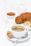 Cup of black coffee and croissants with orange jam Royalty Free Stock Photos