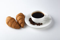 Cup of black coffee with croissants Stock Image