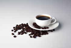 Cup of black coffee with croissants Stock Photography
