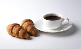 Cup of black coffee with croissants Stock Images