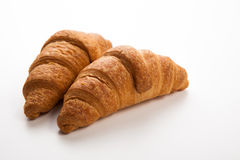 Cup of black coffee with croissants Stock Photos