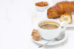 Cup of black coffee and croissants (with space for text) Royalty Free Stock Photo