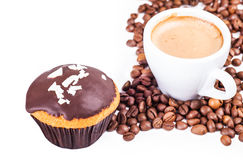 Cup of black coffee and a cupcake Stock Photos