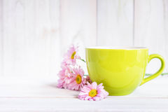Cup of black coffee and daisy flowers on the white table Royalty Free Stock Image