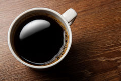 Cup of black coffee on the desk Royalty Free Stock Photography