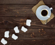 A cup of black coffee (espresso) and sweet marshmallow on a dark wooden background. Stock Images