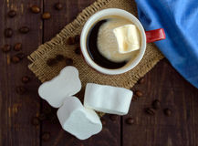 A cup of black coffee (espresso) and sweet marshmallow on a dark wooden background Stock Images