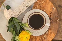 Cup of black coffee and flowers stock photography