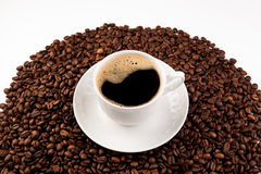 Cup of black coffee with foam. And roasted coffe beans close-up Stock Photo