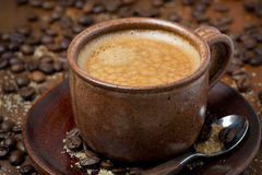 Cup of black coffee with foam, selective focus Royalty Free Stock Photo