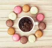Cup of black coffee with french colorful macarons, view from abo Royalty Free Stock Photography