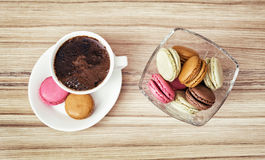 Cup of black coffee with french colorful macarons, view from abo Royalty Free Stock Images