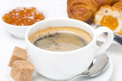 Cup of black coffee, fresh croissants and jam Royalty Free Stock Image