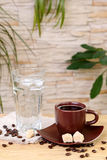 Cup of black coffee and a glass of cold water Royalty Free Stock Images