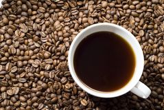 Cup of black coffee with grains Royalty Free Stock Photo