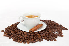 The cup of black coffee with grains Stock Photo