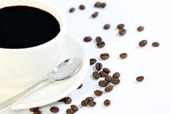 Cup of black coffee with grains close up Royalty Free Stock Photos
