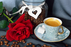 Cup of black coffee, heart and red rose Stock Photo