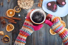 Cup of black coffee in his hands over the table Stock Photos