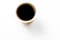 A cup with black coffee. An isolated cup with black coffee Royalty Free Stock Photography