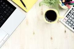 Cup of black coffee and labtop keyboard with financial office supply Stock Photos