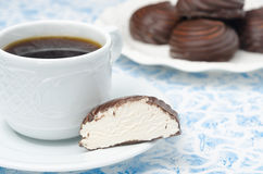 Cup of black coffee and marshmallows in a cut in the chocolate Royalty Free Stock Images