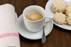 Cup of black coffee and marshmallows Royalty Free Stock Photo