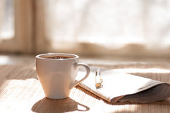 Cup of black coffee, newspaper and a pen against Stock Images