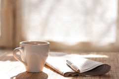 Cup of black coffee, newspaper and a pen Stock Images