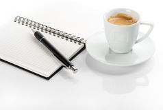 Cup of black coffee and note book Royalty Free Stock Photos
