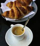 The cup of black coffee with paris croissant Royalty Free Stock Images