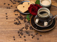 Cup of black coffee with red rose flower Stock Image
