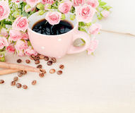 Cup of black coffee and red rose. Stock Image