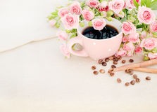 Cup of black coffee and red rose. Stock Photos