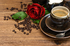 Cup of black coffee and red rose flower Royalty Free Stock Images