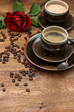 Cup of black coffee and red rose flower Stock Photography