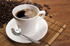 Cup of black coffee with roasted coffe beans Stock Image