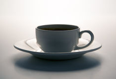 Cup of black coffee with roasted coffe beans with title espresso Royalty Free Stock Photography